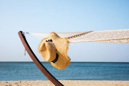 Hammock and hat at seaside. Time to relax