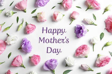 Flat lay composition of beautiful eustoma flowers and text Happy Mothers Day on white background