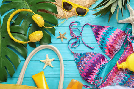 Flat lay composition with beach accessories on light blue wooden background Zdjęcie Seryjne