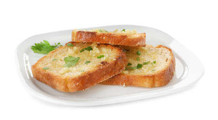 Slices of toasted bread with garlic and herb on white background