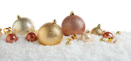 Christmas tree decoration on artificial snow against white background Archivio Fotografico - 129830206