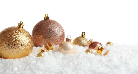 Christmas tree decoration on artificial snow against white background