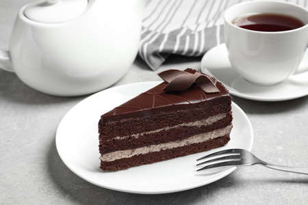 Delicious fresh chocolate cake served on light grey table