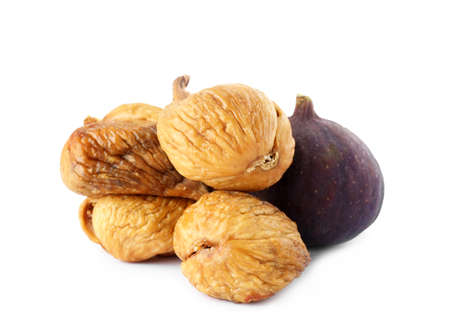 Tasty dried and raw figs on white background Stock Photo