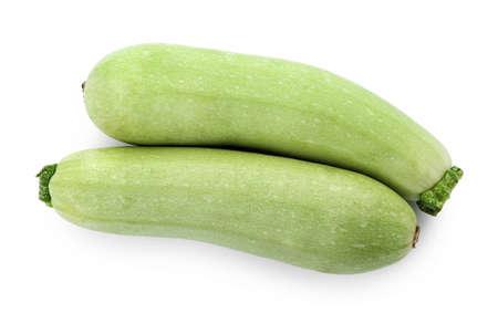 Fresh ripe zucchini squashes on white background, top view Stock Photo