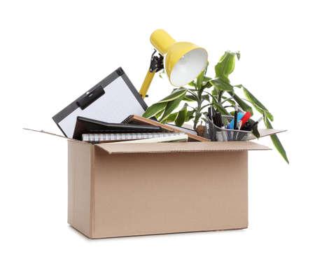 Cardboard box full of office stuff on white background Banco de Imagens