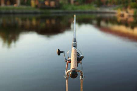 Fishing rod at lake on sunny day 스톡 콘텐츠