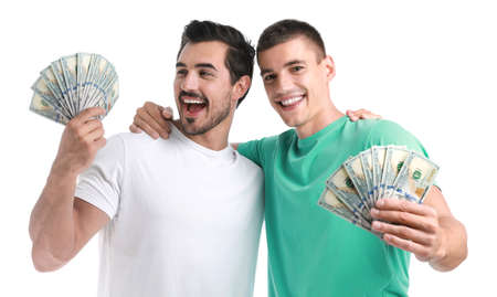 Handsome young men with dollars on white background