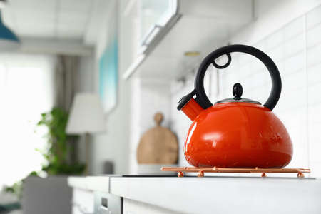 Modern kettle on kitchen counter indoors, space for text Stockfoto