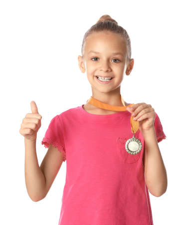 Happy girl with golden medal on white background