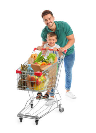 Father and son with full shopping cart on white background