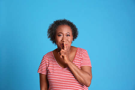 Portrait of African-American woman on light blue background Stock Photo