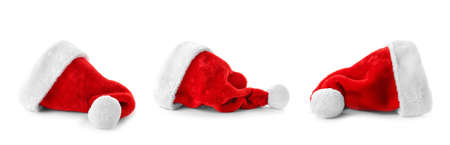 Set of red Santa Claus hats on white background