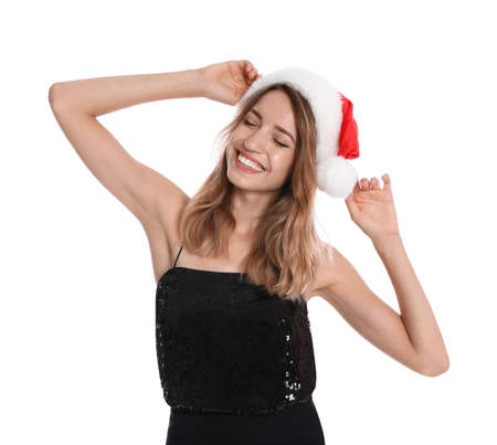 Happy young woman in Santa hat on white background. Christmas celebration Foto de archivo - 129993978