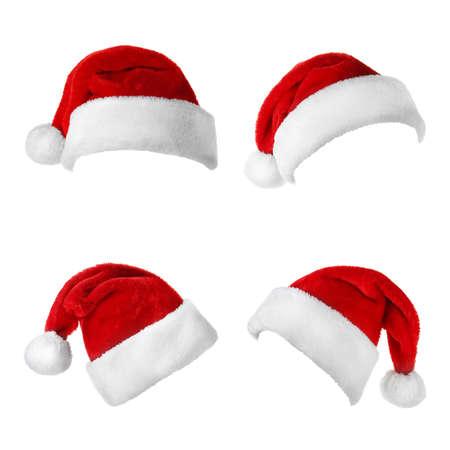 Set of red Santa Claus hats on white background Фото со стока - 129920060
