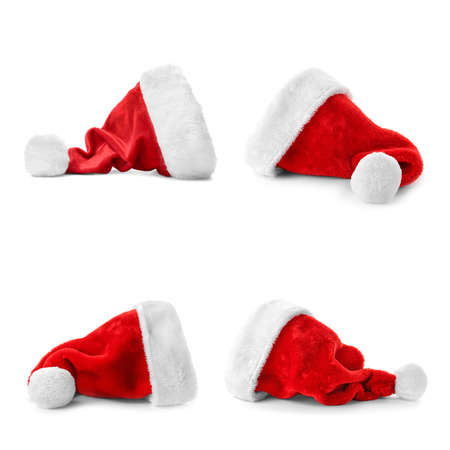 Set of red Santa Claus hats on white background Stock fotó