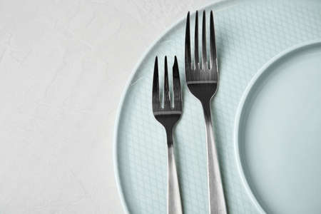 Beautiful table setting on grey background, top view. Space for text