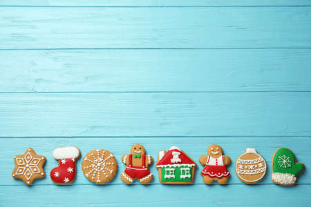 Flat lay composition with tasty homemade Christmas cookies on light blue wooden table, space for text Stockfoto