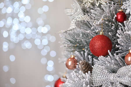 Beautiful Christmas tree with festive decor against blurred lights on background. Space for text Reklamní fotografie