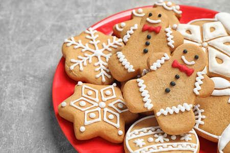 Tasty homemade Christmas cookies on grey table