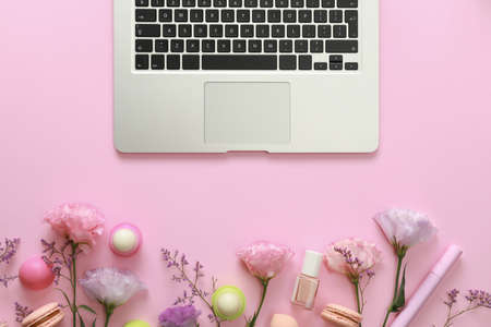 Flat lay composition with laptop on pink background. Beauty blogger's workplace Reklamní fotografie - 130072841