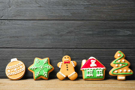Tasty homemade Christmas cookies on table, space for text