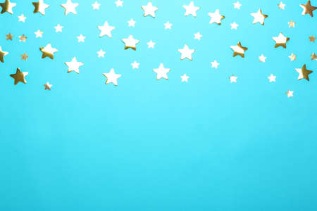 Confetti stars with space for text on blue background, top view. Christmas celebration