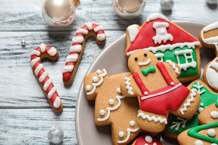Tasty homemade Christmas cookies on white wooden table, closeup view