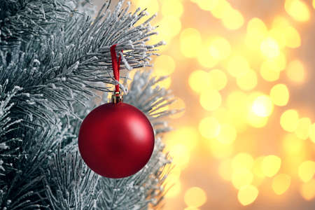 Decorated Christmas tree against blurred lights on background. Bokeh effect