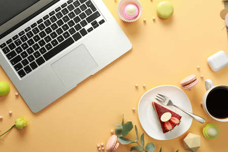 Flat lay composition with laptop on beige background. Food bloggers workplace