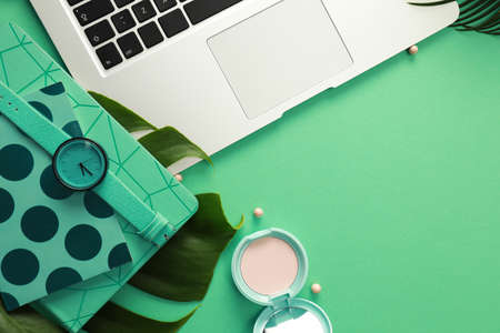 Flat lay composition with laptop on green background. Fashion blogger Stock fotó