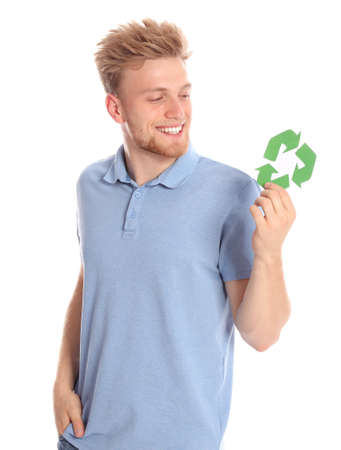 Young man with recycling symbol on white background