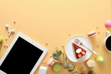 Flat lay composition with tablet on beige background. Food bloggers workplace Stock Photo