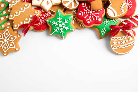 Tasty homemade Christmas cookies on white background, top view Фото со стока