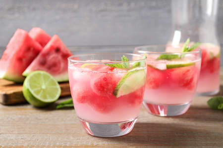 Tasty refreshing watermelon drink on wooden table