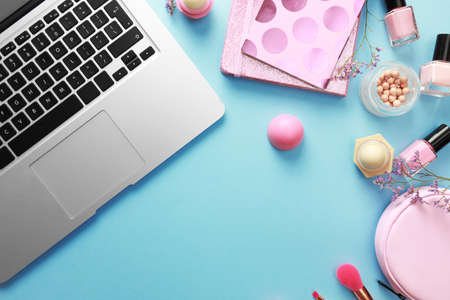 Flat lay composition with laptop on blue background. Beauty bloggers workplace Zdjęcie Seryjne