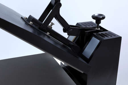 Heat press machine on light background, closeup view