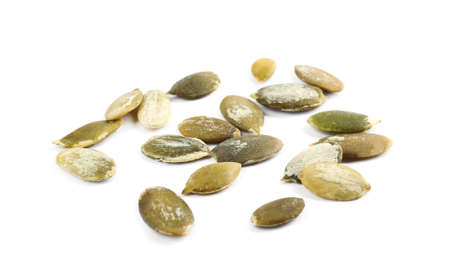 Raw peeled pumpkin seeds on white background Stock fotó