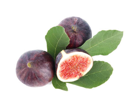 Fresh juicy purple figs and green leaves on white background, top view
