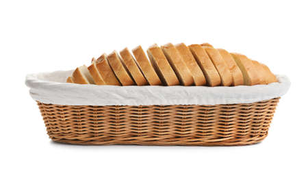 Sliced tasty fresh bread in wicker basket on white background Imagens