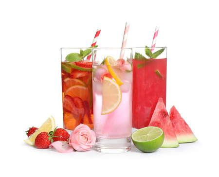 Glasses of tasty refreshing drinks on white background