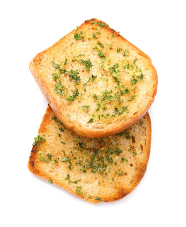 Slices of toasted bread with garlic and herbs on white background, top view Imagens
