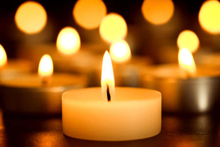 Burning candle on table, closeup. Funeral symbol Stock Photo