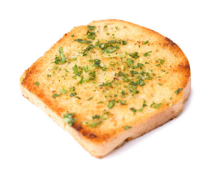 Slice of bread with garlic and herbs on white background