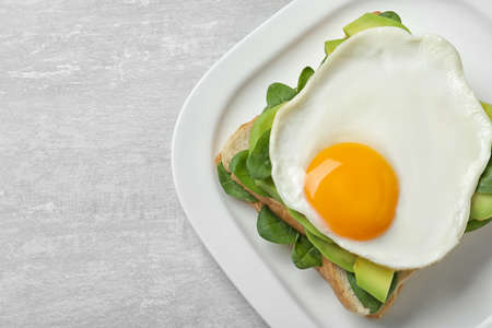 Delicious breakfast with fried egg served on table, top view. Space for text Imagens