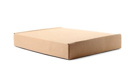 Closed cardboard box on white background. Mockup for design