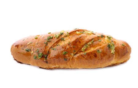 Bread loaf with garlic and herbs on white background