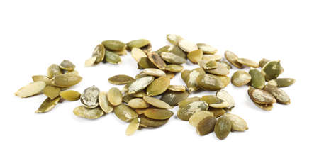 Raw peeled pumpkin seeds on white background Фото со стока