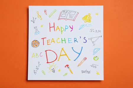 Paper with inscription HAPPY TEACHER'S DAY on orange background, top view