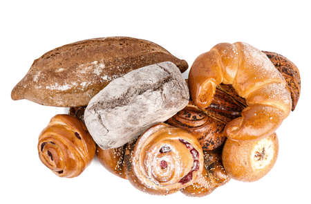 Fresh breads and pastries on white background, top view Фото со стока